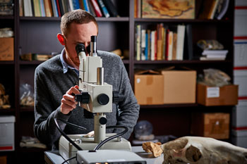 Student with Microscope
