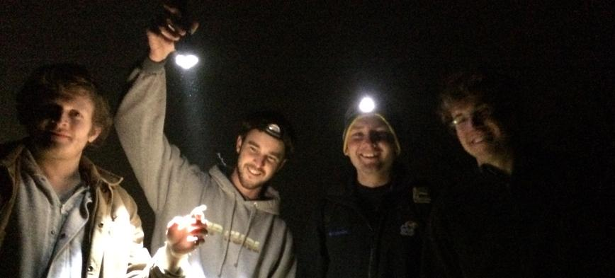 KU Herpetology students Carl Hutter, Scott Travers, Matt Buehler, and Kerry Cobb celebrate the emergence of Ambystoma texanum at the Baker wetlands in April of 2014.